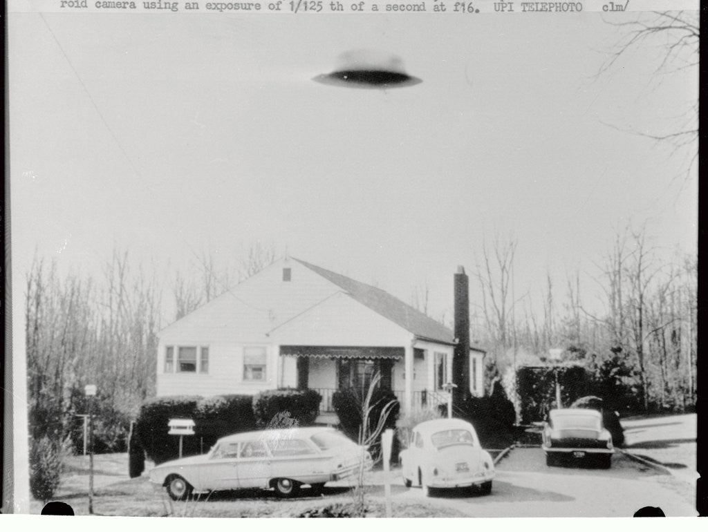 Detail of Supposed Unidentifiable Flying Object over House by Corbis