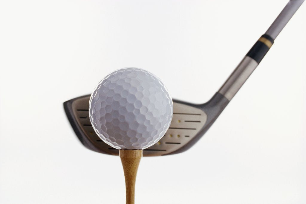 Detail of Golf Ball, Tee, and Club by Corbis