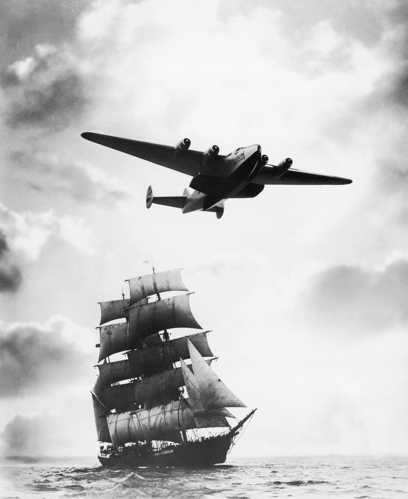 Detail of Airplane Flying over Ship by Corbis