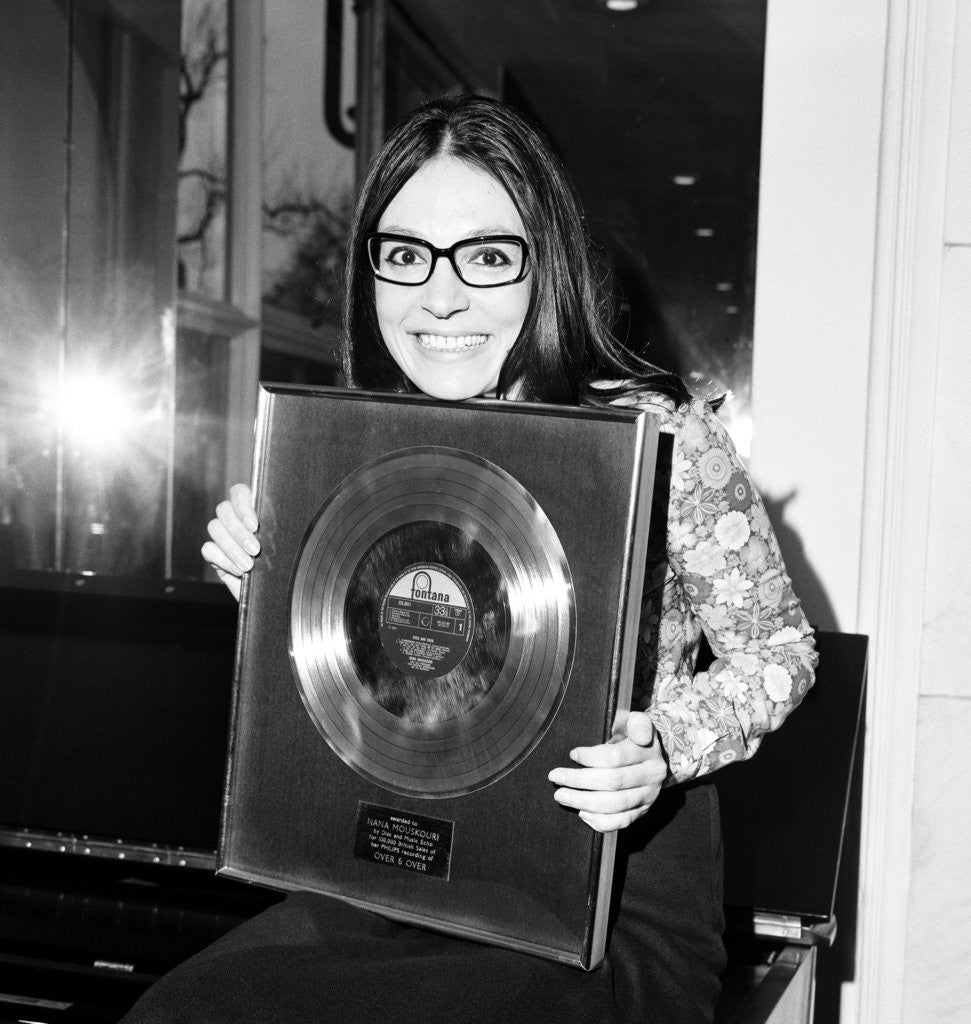 Detail of Nana Mouskouri presented with a gold disc by Maurice Kaye