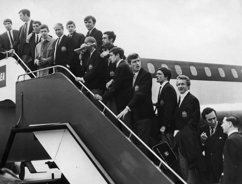 Detail of Manchester United boarding a plane at Manchester Ringway airport by Staff