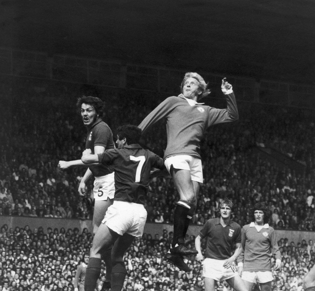 Detail of Denis Law seen here in action against Ipswich at Old Trafford by Staff