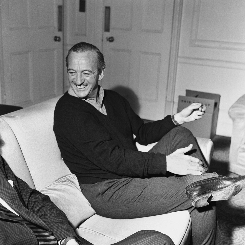 Detail of David Niven relaxing in his London hotel suite by Malcolm MacNeil