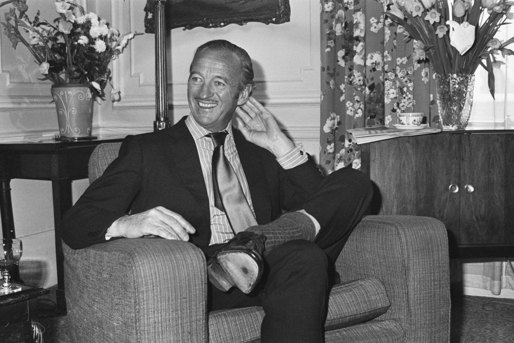Detail of David Niven relaxes in his hotel suite in London by Anonymous