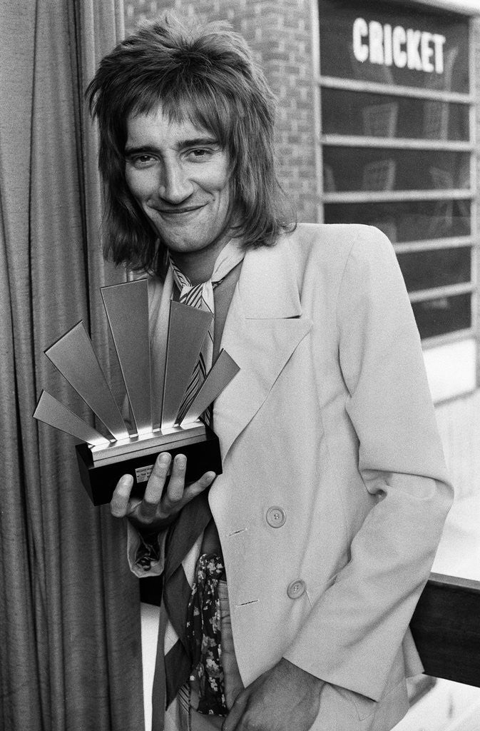 Detail of Rod Stewart with his Top Male Singer Award by Staff