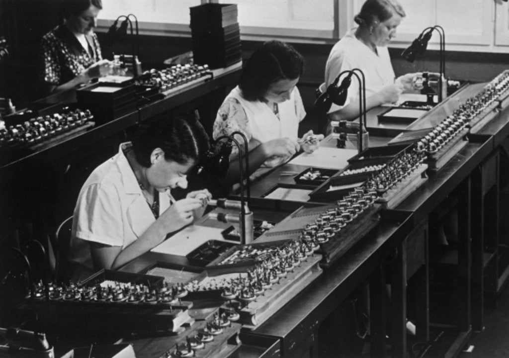 Detail of Assembly line for television broadcasting equipment at the Telefunken manufacturing plant, Berlin by German Photographer