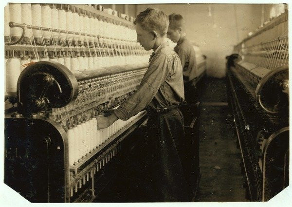 Detail of Doffers replacing full bobbins at Indian Orchard Cotton Mill, Massachusetts by Lewis Wickes Hine