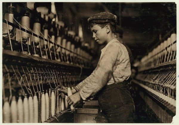 Detail of A doffer replaces full bobbins at Globe Cotton Mill, Augusta, Georgia by Lewis Wickes Hine