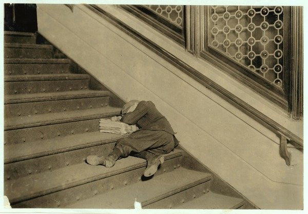Detail of Newsboy asleep with his papers in Jersey City, New Jersey by Lewis Wickes Hine