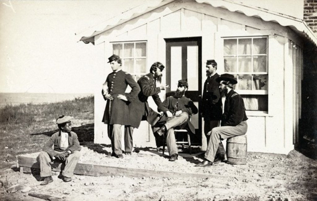 Detail of Five Civil War soldiers gathered on dirt porch outside home, African American youth seated near them by American Photographer