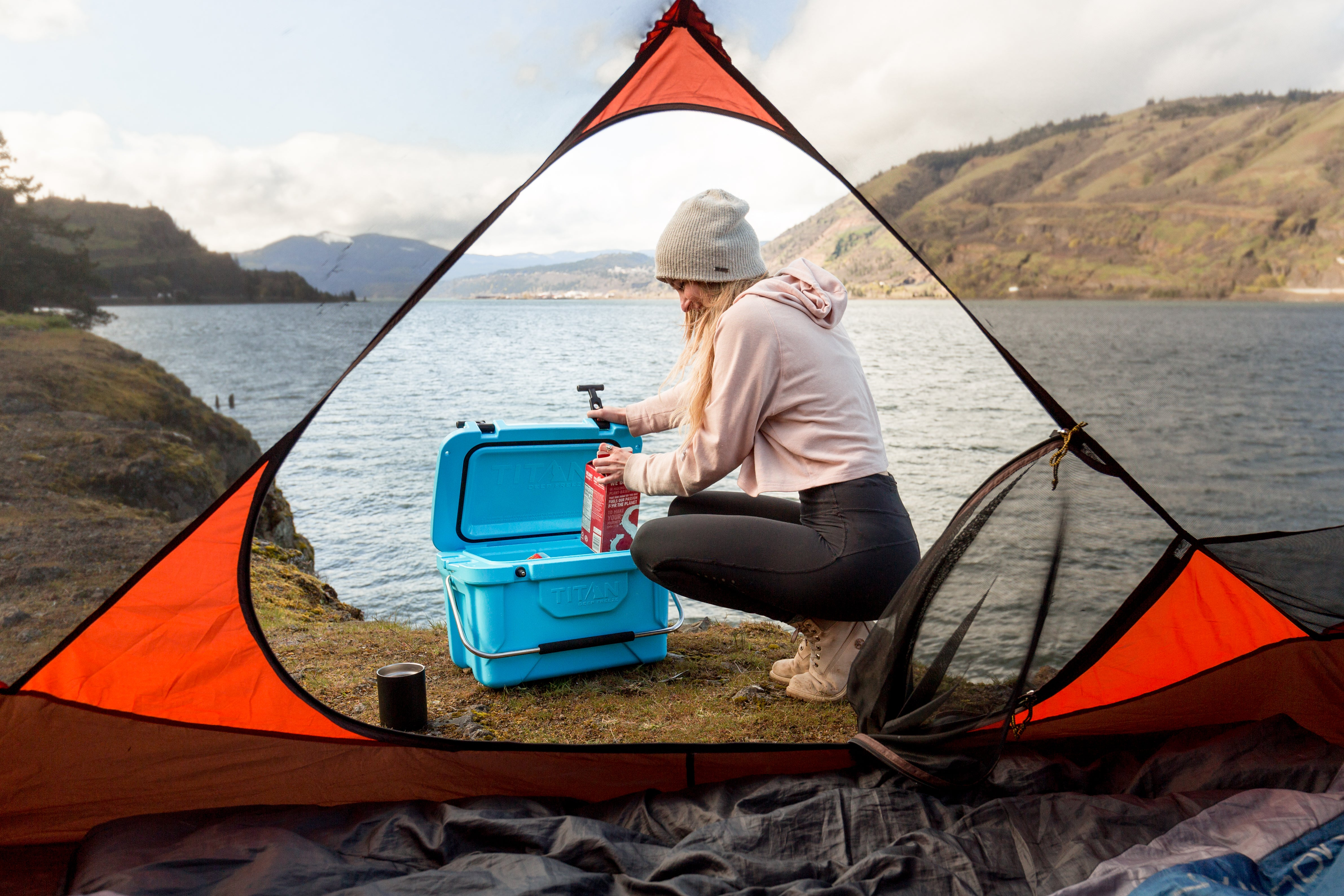Camping with Arctic Zone - packing milk into the cooler, view from inside the tent - Best coolers for camping