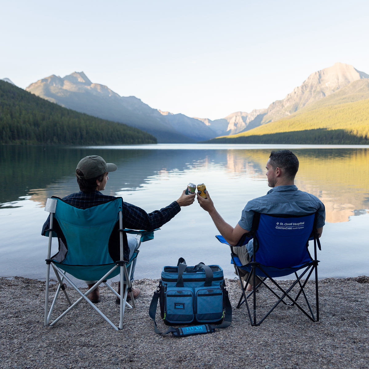 Titan Guide Series™ 36 Can Cooler - Lifestyle, having a drink next to the lake