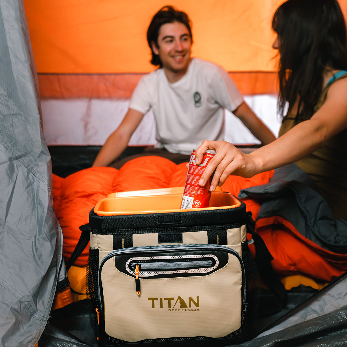 Titan Deep Freeze® 16 Can Zipperless™ HardBody® Cooler - Moss - Lifestyle, having a drink after setting up camp