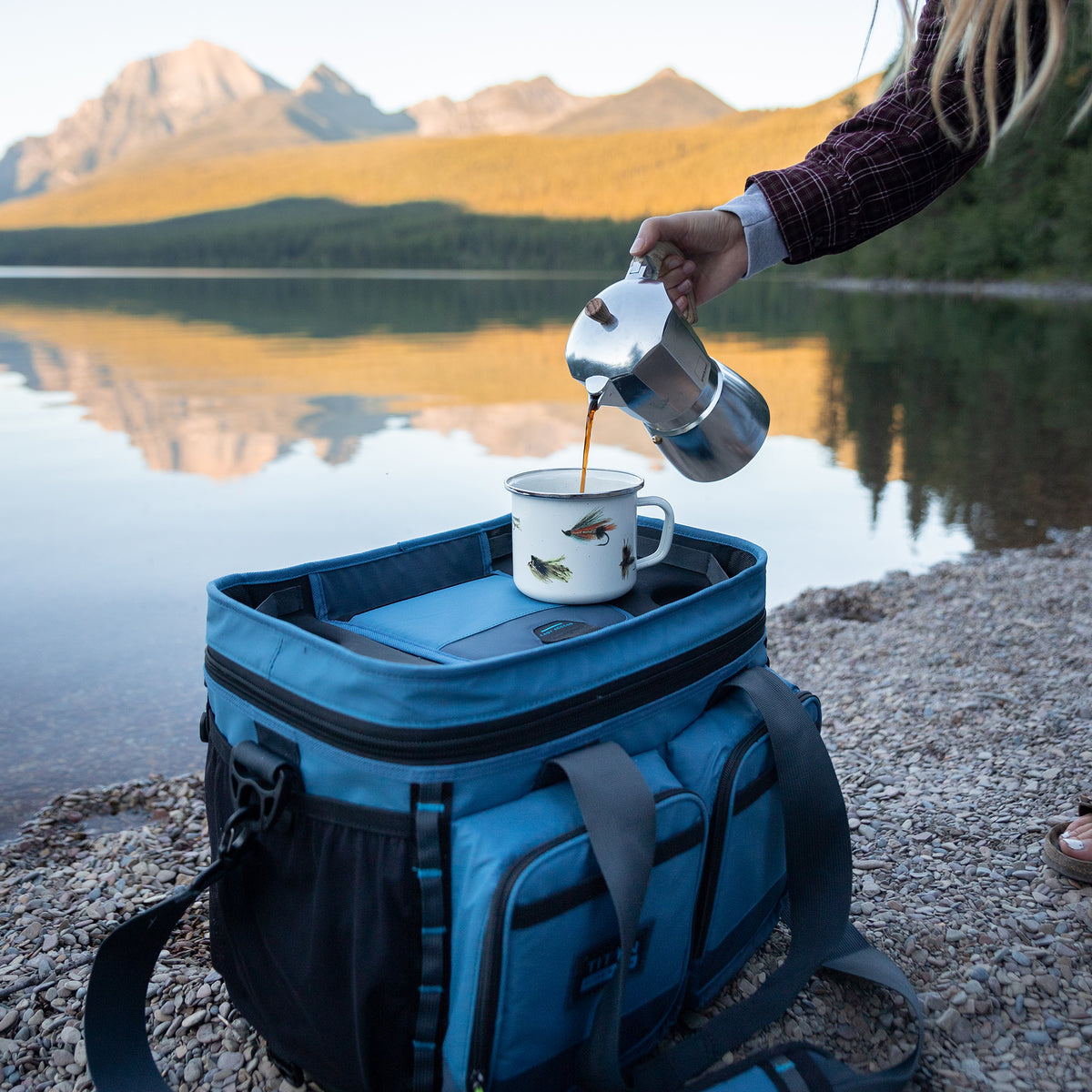 Titan Guide Series™ 36 Can Cooler - Lifestyle, pouring some coffee on top of the cooler