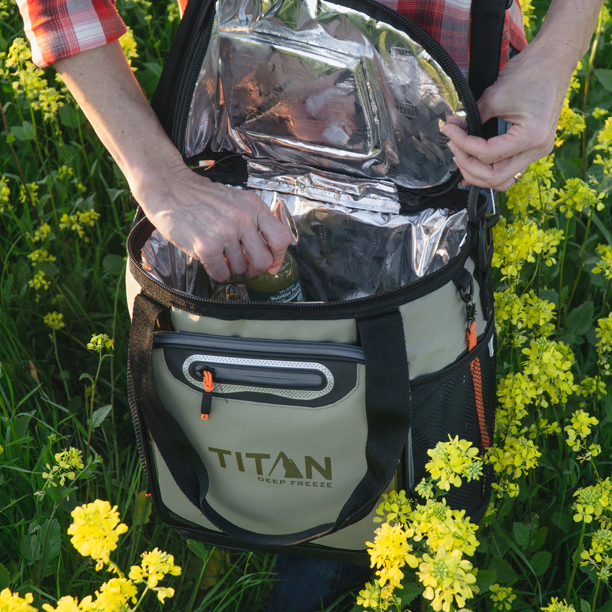 Titan Deep Freeze® 24 Can Bucket Tote - Tan - Lifestyle, reaching for a drink