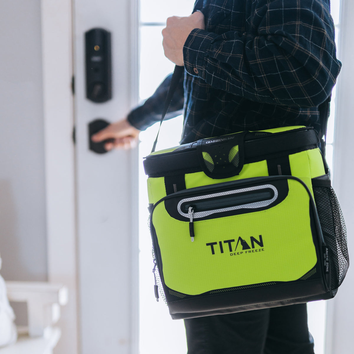 Titan Deep Freeze® 16 Can Zipperless™ HardBody® Cooler - Citrus - Lifestyle, model carrying cooler