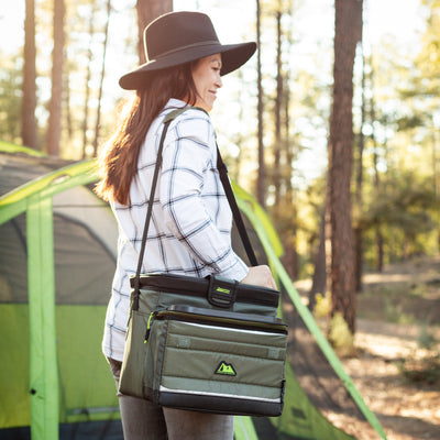 Arctic Zone® 30 (24+6) Can Ultimate Zipperless™ HardBody® Cooler - Green - Lifestyle, carrying the cooler around the camp site
