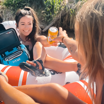 Titan Deep Freeze® 9 Can Zipperless™ HardBody® Cooler - Blue - Lifestyle, Passing drinks in the pool
