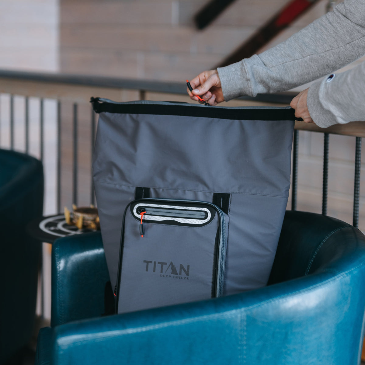 Titan Deep Freeze® 20 Can Rolltop Backpack - Sharkskin Gray - Lifestyle, model packing cooler