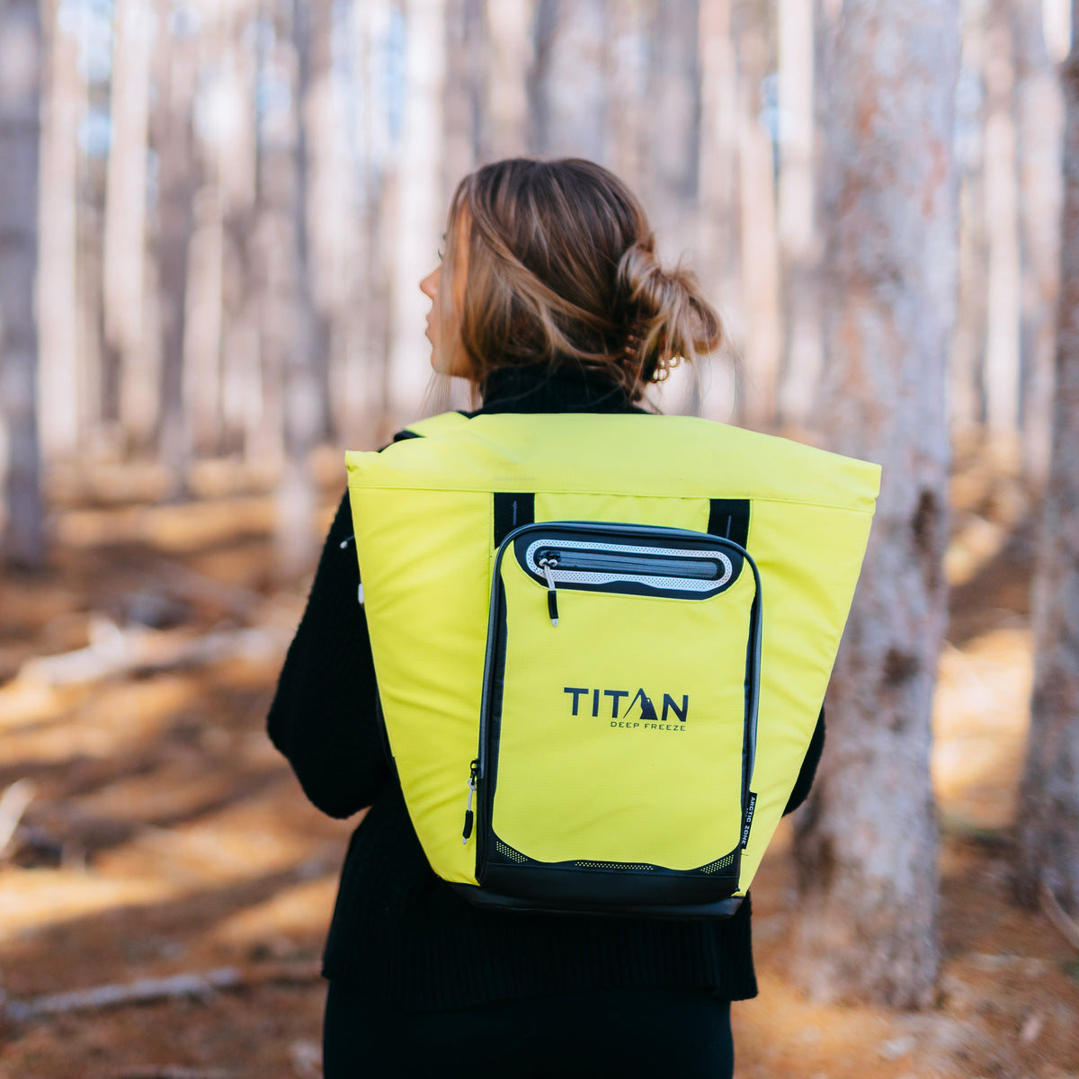Titan Deep Freeze® 20 Can Rolltop Backpack - Citrus - Lifestyle, model wearing backpack cooler