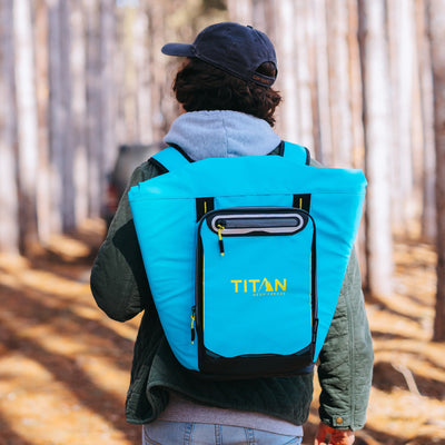 Titan Deep Freeze® 20 Can Rolltop Backpack - Blue Lagoon - Lifestyle, model wearing backpack cooler