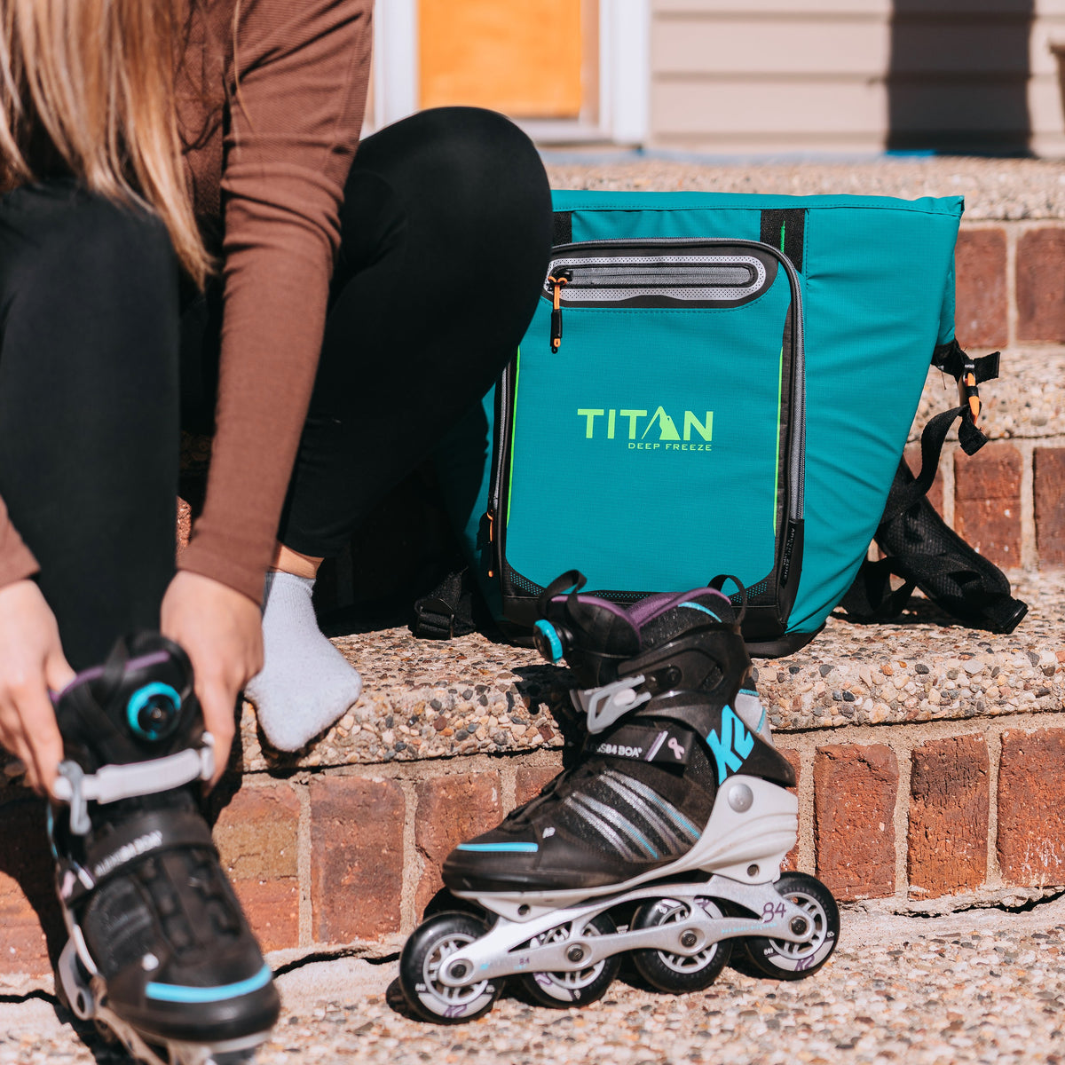 Titan Deep Freeze® 20 Can Rolltop Backpack - Pine - Lifestyle, model rollerskating with cooler