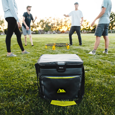 Arctic Zone® 40 Can Zipperless™ HardBody® Cooler - Grey/Green - Lifestyle, cooler next to friends playing on a field