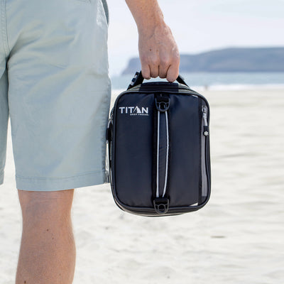 Titan Deep Freeze® Expandable Lunch Box - Black - Lifestyle, bringing a snack to the beach