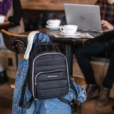 Arctic Zone® Quilted Cooler Backpack - Black - Lifestyle, studying at a cafe