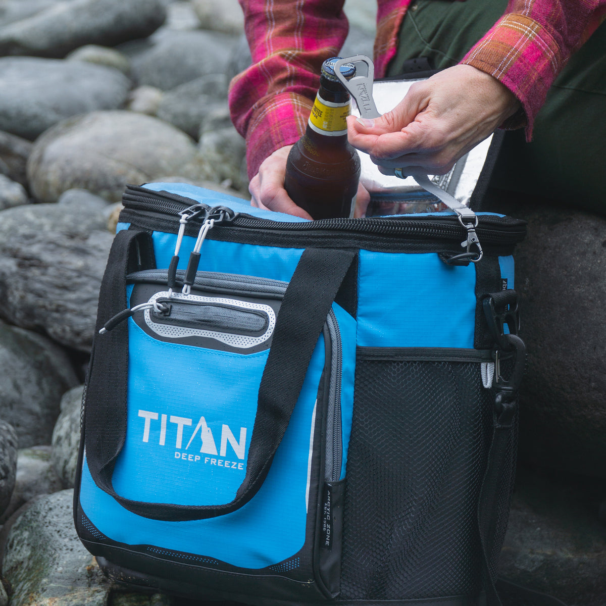 Titan Deep Freeze® 24 Can Bucket Tote - Blue - Lifestyle, grabbing and opening opening a bottle