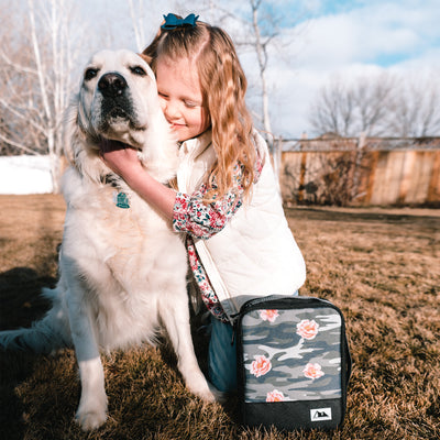 Arctic Zone Expandable Urban Lunch Pack - Rose Camo - Lifestyle, hugging the dog