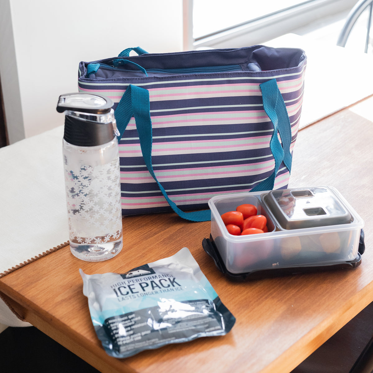 Arctic Zone® Commuter Tote - Mixed Stripes - Lifestyle, having a quiet lunch