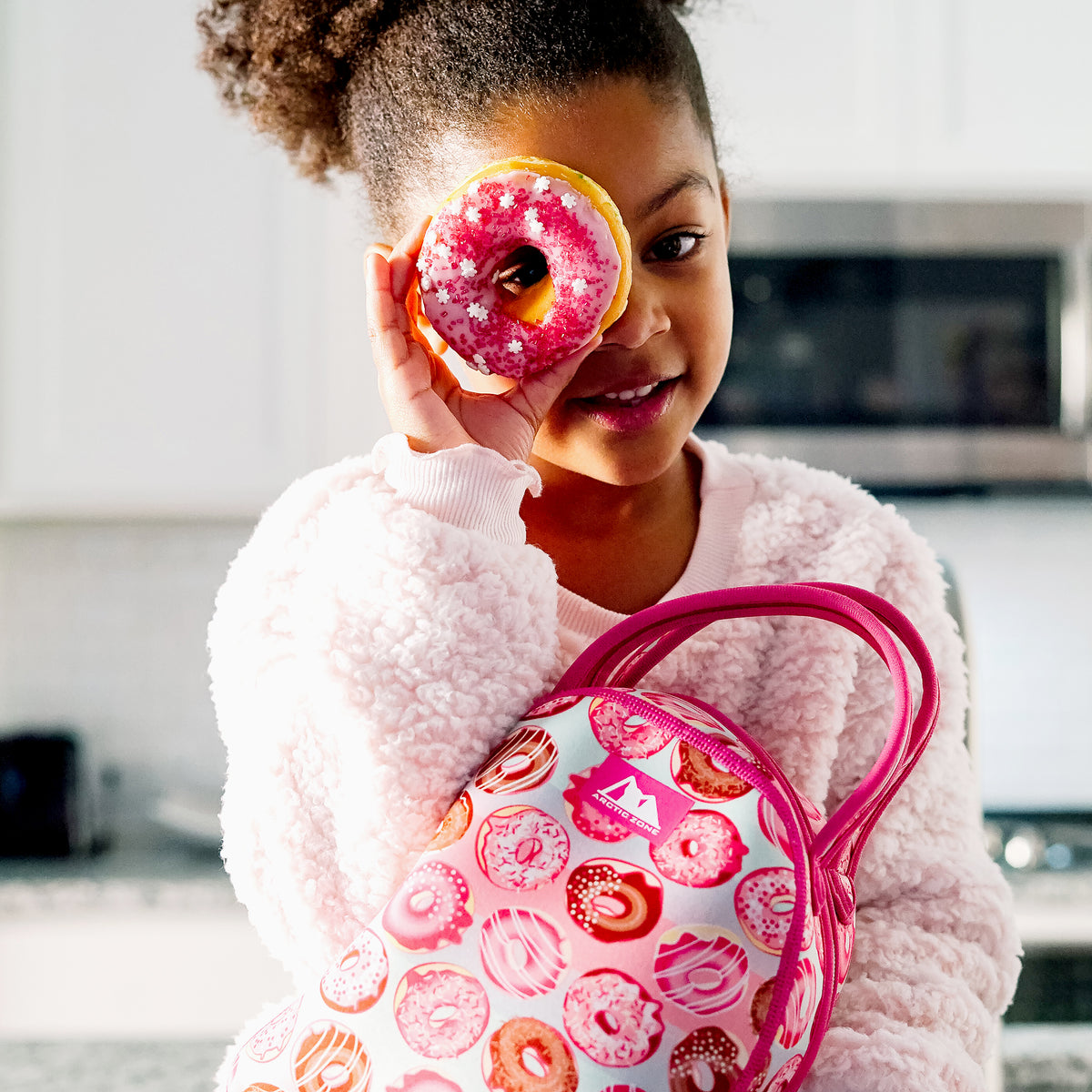 Arctic Zone® Neoprene Hannah Tote - Lifestyle, girl looking through doughnut hole