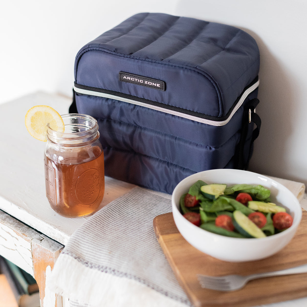 Arctic Zone® Crossbody Quilted Lunch Pack - Majolica Blue - Lifestyle, having a lunch break