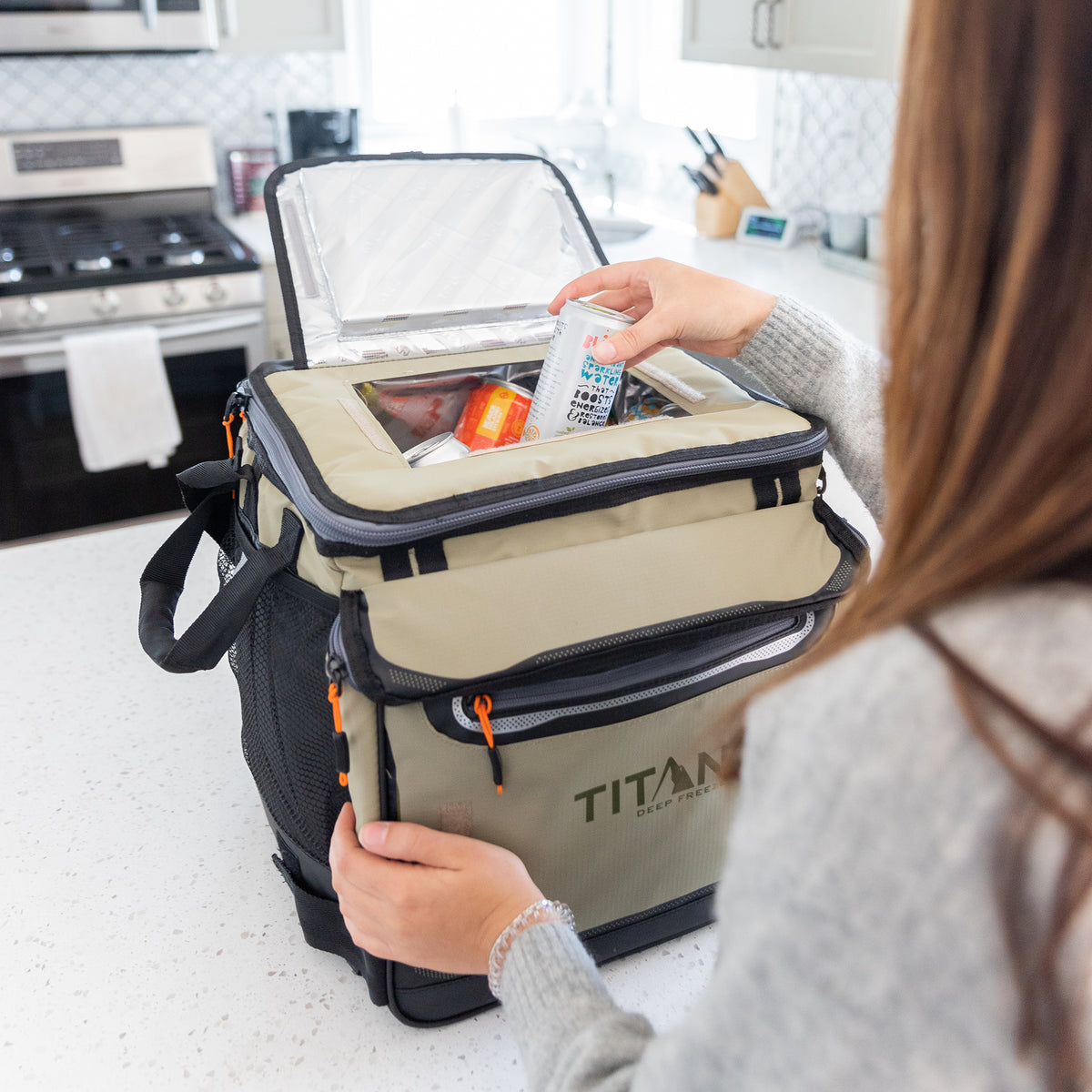 Titan Deep Freeze® 60 (50+10) Can Rolling Cooler - Moss - Lifestyle, unpacking groceries at home