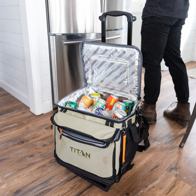 Titan Deep Freeze® 60 (50+10) Can Rolling Cooler - Moss - Lifestyle, packing the cooler full of drinks at home