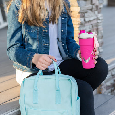 Arctic Zone® 20oz Super Chug™ Stainless Steel - Pink - Lifestyle, having a col drink while on the way to class