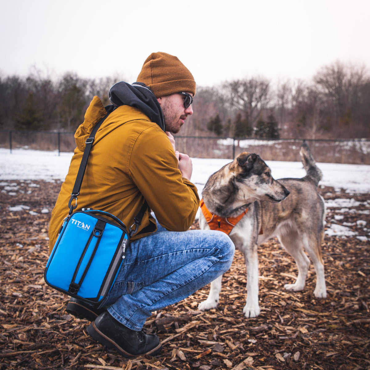 Titan Deep Freeze® Expandable Lunch Box - Blue - Lifestyle, taking the dog for a walk