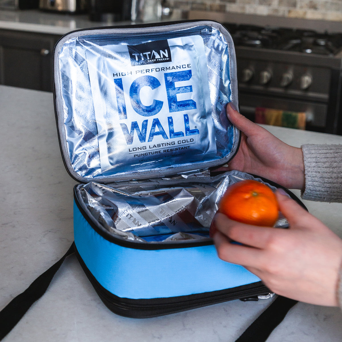 Titan Deep Freeze® Expandable Lunch Box - Blue - Lifestyle, Packing lunch bag showing off ice wall