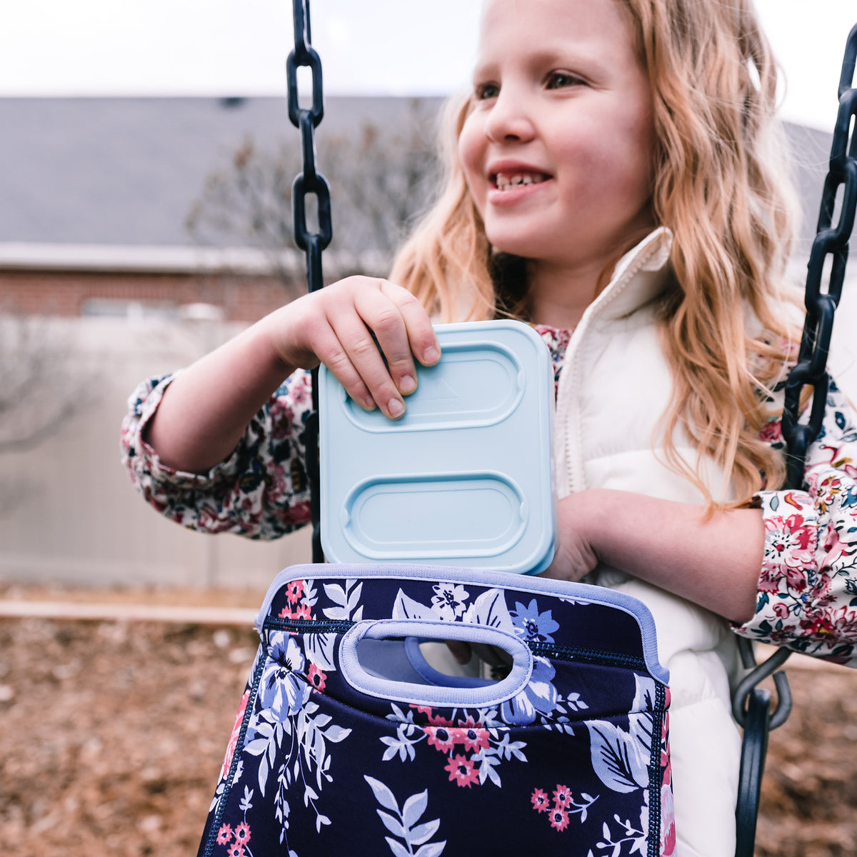 Arctic Zone® Neoprene Zaza Tote - Lifestyle, little girl packing lunch on a swing set