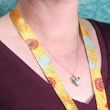 Buttonsmith Van Gogh Sunflower Lanyard being worn against bare skin on neck