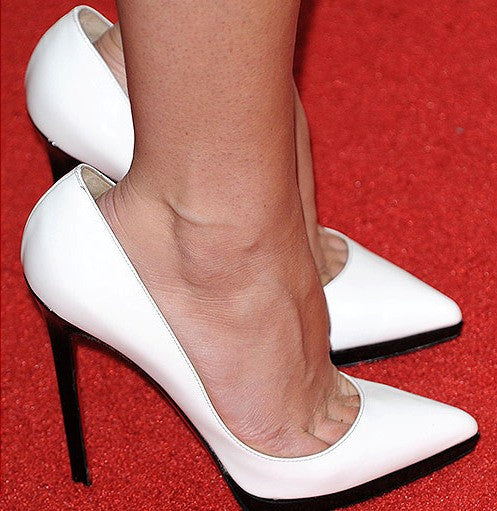 Question from a woman with narrow feet. She has trouble buying high heels that fit, and has recently bought heels that are medium width. She needs advice about how to make them more comfortable.