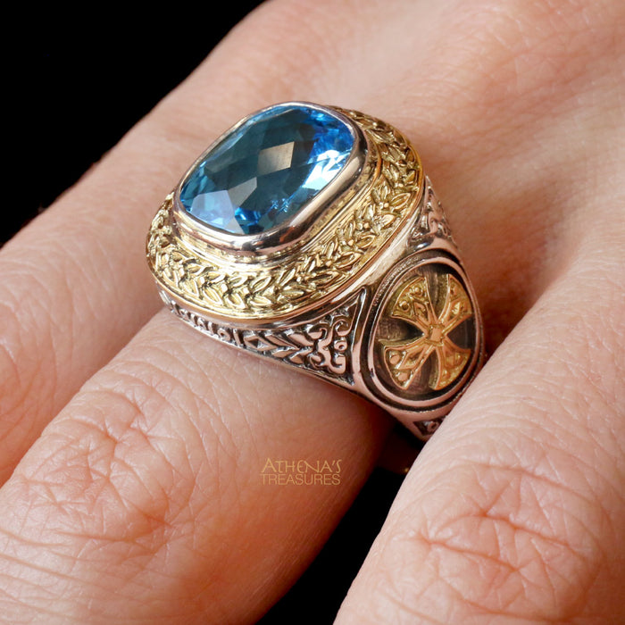 Cross Flanked Topaz Ring