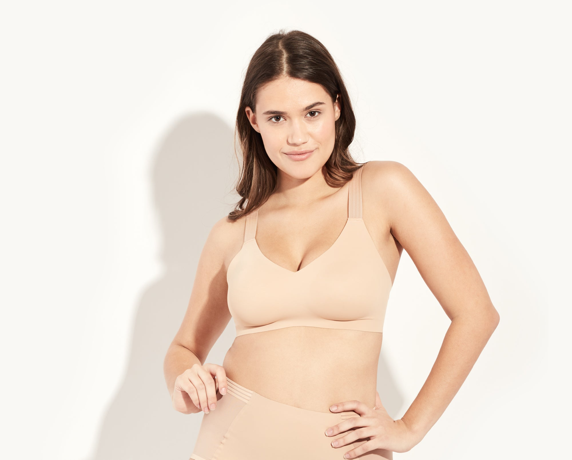 Luma is a 34D, she's wearing a size 4 bra. Her bottoms are the Luxe High Rise. color: Beige