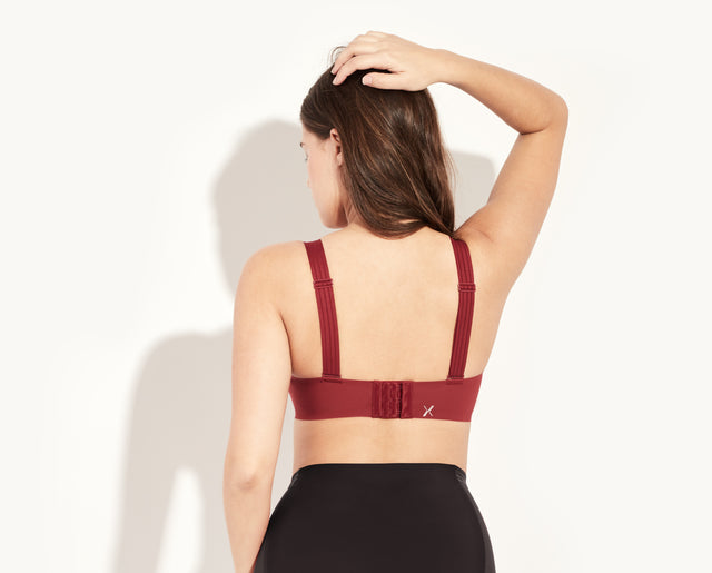 Luma is a 34D, she's wearing a size 4 bra. Her bottoms are the Luxe High Rise. color: Cranberry