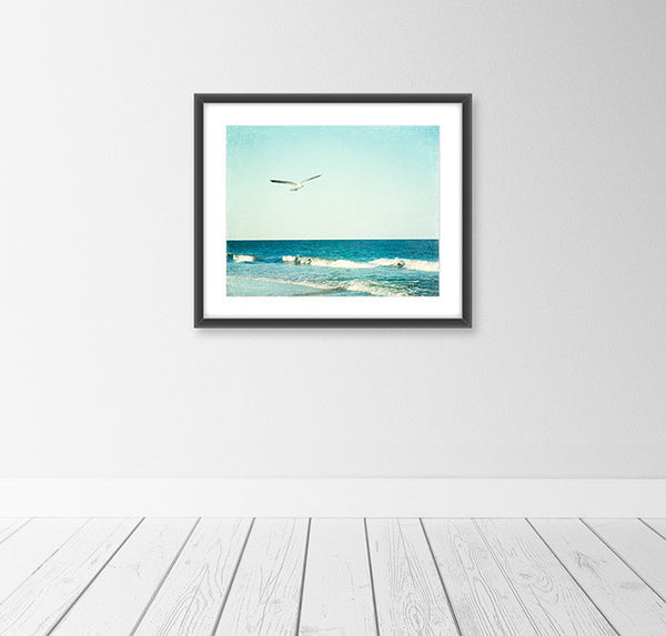 Seagull Flying over Ocean Photography Art by CarolynCochrane.com