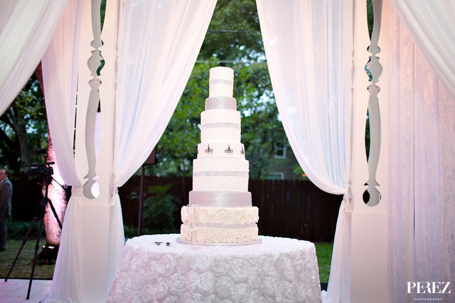 tall wedding cake drapping fancy formal highend