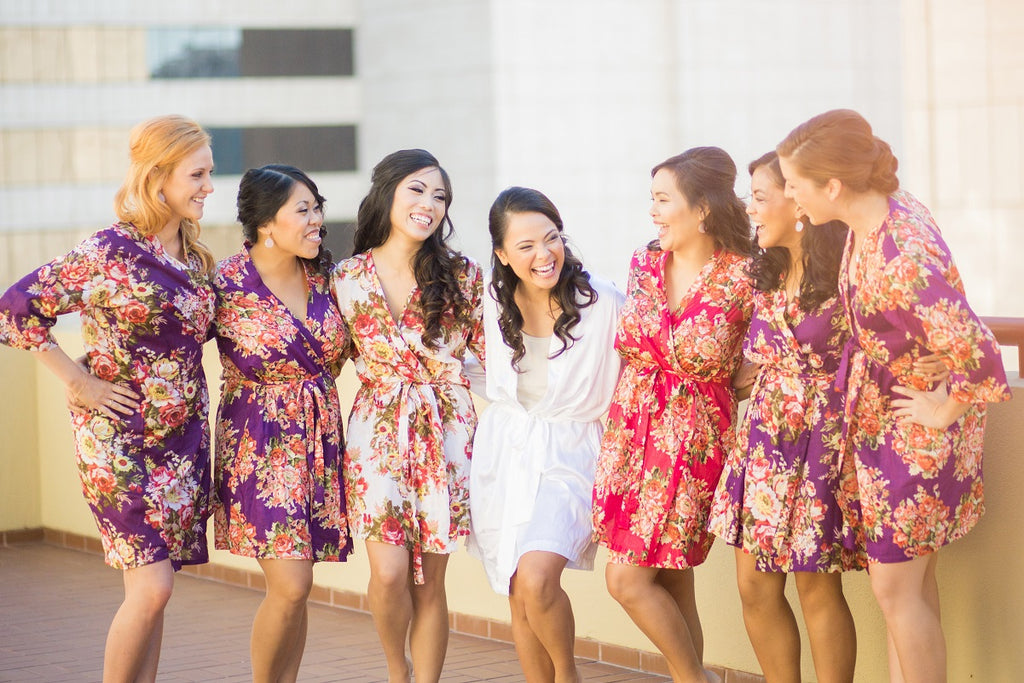 Bride and bridesmaids wearing flower silk robes