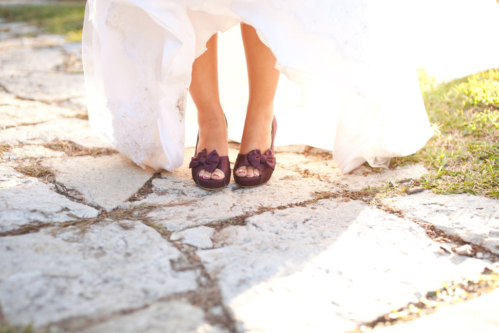 purple wedding shoes heels bow cobble path stone