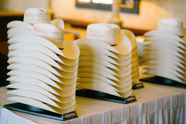 Stack of Cowboy Hats as Favors at Wedding or Event